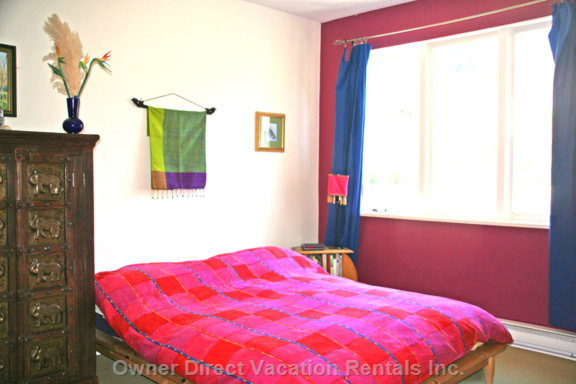 Vibrant Master Bedroom with Queen Bed