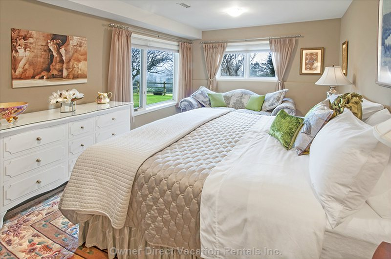 Master Bedroom with King Pillow Top Bed, Fine Linens, a Comfortable down Chesterfield. Wake from a Blissful Sleep to Beautiful Views.