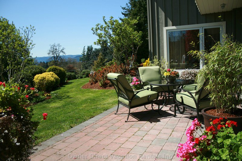 Looking over the Grounds . Enjoy the Captivating View of the Valley through to the Olympic Mountains of Washington.