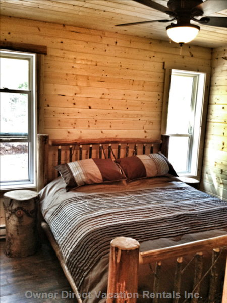 The Main Bedroom has a Queen Sized Log Bed