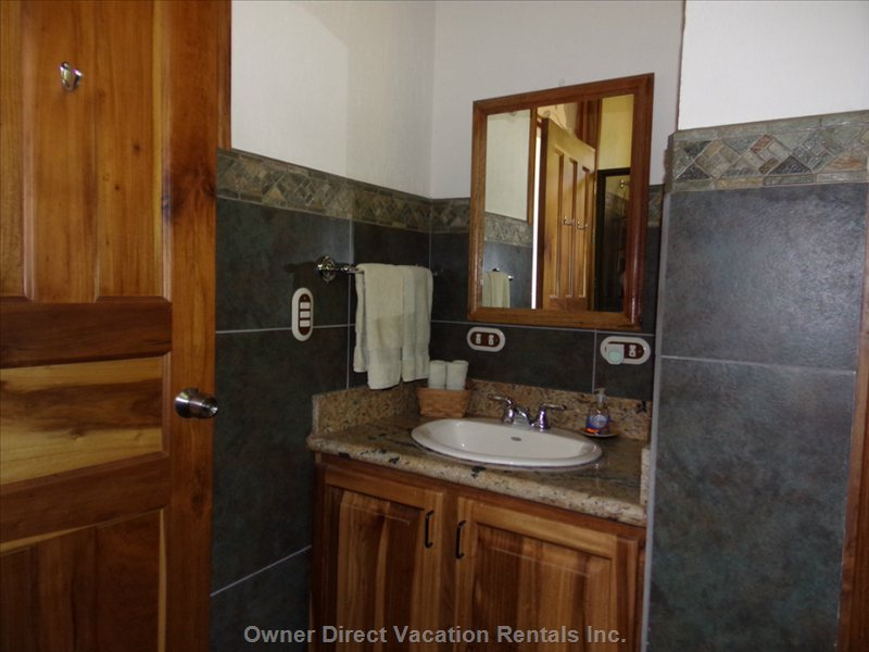 Tastefully Appointed Ensuite Bathrooms with Real Hot Water. Soaps, Shampoos, Soft Towels and Luxurious Bathrobes Provided.