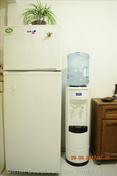 Frigiraire and Osmosis Hot and Cold Water Dispenser.