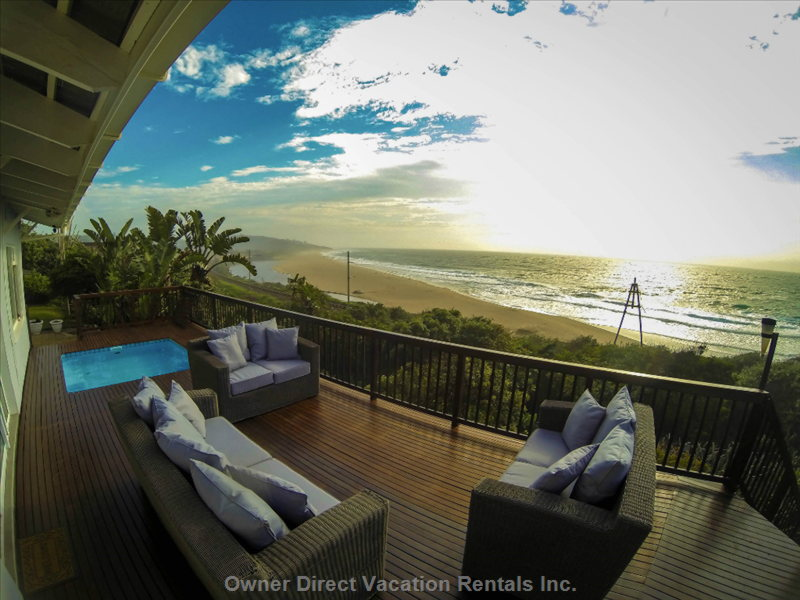 Amanzi Private Deck and Pool, over Looking the Mighty  Indian Ocean and Umzumbe Estuary.  5  Bedrooms, and Sleeps 12.
