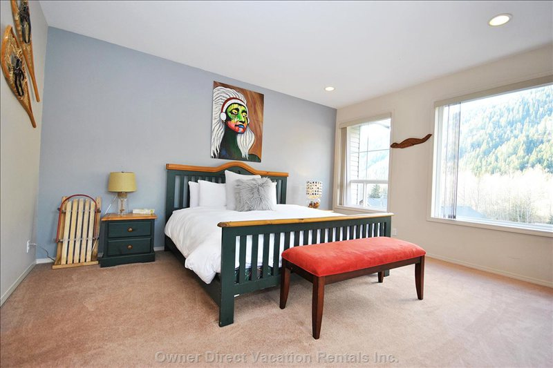 Extremely Spacious Master Bedroom with a King Bed and Huge Windows with a Fantastic View of MT Tod