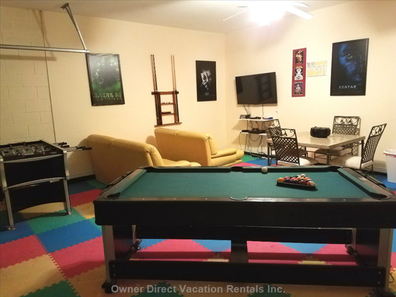 Game Room with playstation4, Pool Table and Foosball Table.