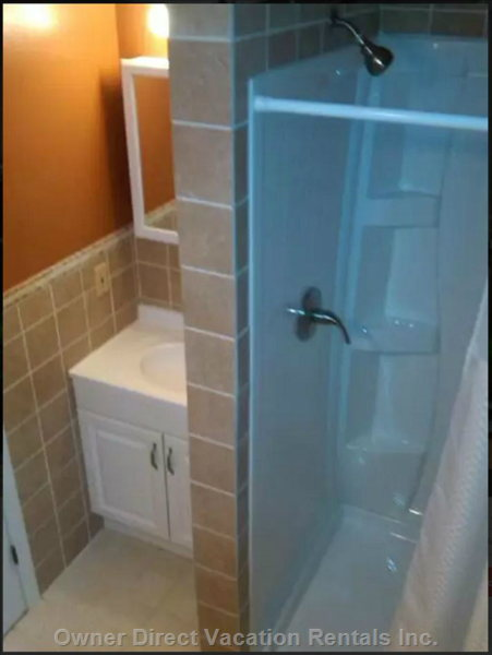 Full Lower Level Bathroom has Shower Sink Wc and Hairdryer as Part of the in-Law Apartment