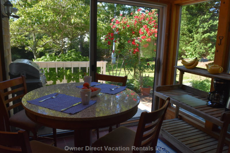 Sunroom is Adjacent to the Kitchen and Dining Room and Overlooks the Gardens.