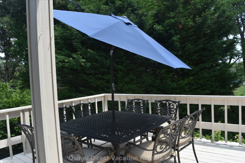 The Table Also has a 9 Foot Tilt Umbrella