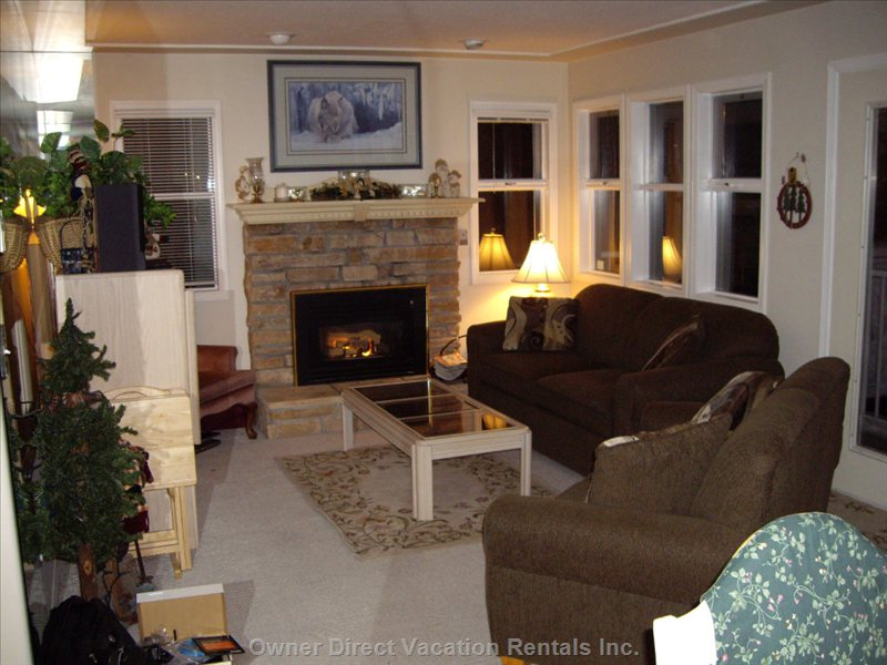 Living Room - Comfortable and Cozy by the Fireplace and Lots of Windows to Enjoy the Beautiful Outdoors