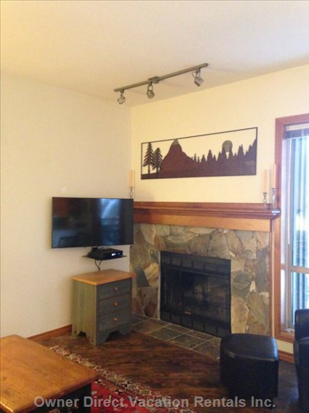 Wood Burning Fireplace with Flat Screen Tv