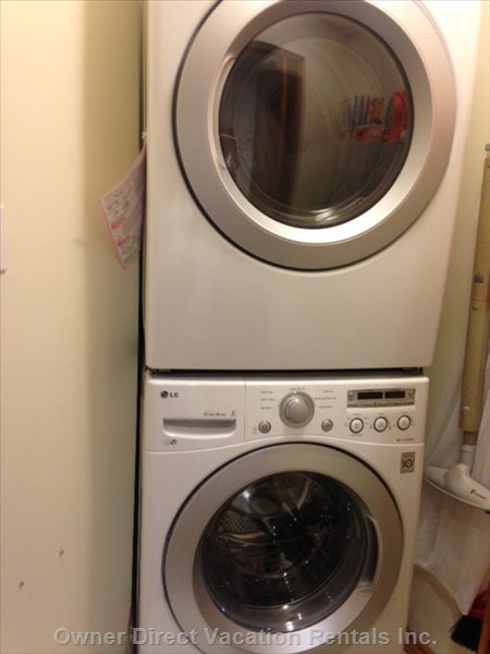 Brand New Full Size Washer and Dryer in Laundry Room