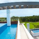 Roof Top Infinity Pool with Views over the Golf Course to Cozumel