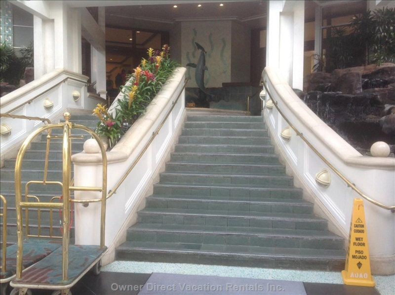 Staircase & Escalators Leading to the Main Lobby. This is Right Next to the Bell Boys