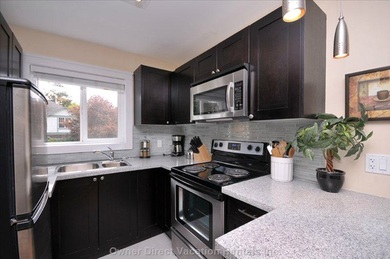 Renovated Kitchen with Stainless Steel Appliances and Granite Counters.