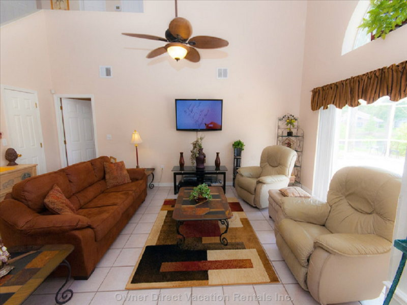 "Living Room with Large 50"" hd Tv and Dvd Player with Premium Cable Package"